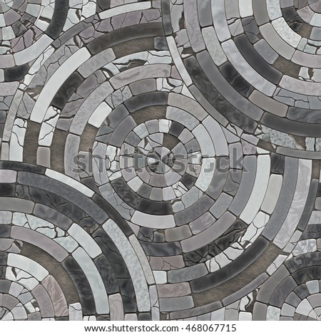 Cobble circular mosaic. Seamless texture of paving stones. Pattern of gray stone tiles.