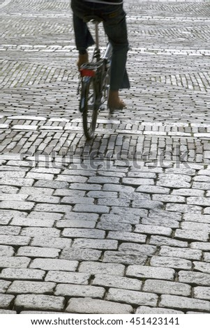 Cobble Stones and Cyclist, Den Haag - the Hague; Holland; Netherlands