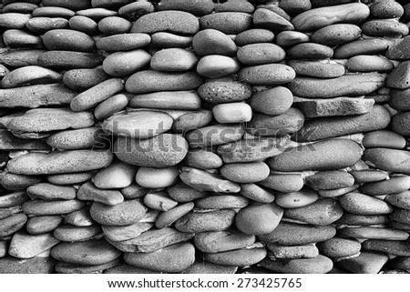 Cobble stones grey wall