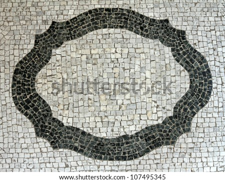 cobbled background with frame motif - stock photo
