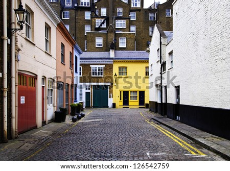 Cobbled street and colorful brick houses in London, England, UK - stock photo