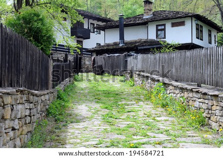 Cobbled street in old Bozhentsi village in Bulgaria - stock photo