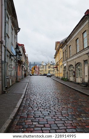 cobbled streets of old Tallinn in rainy weather - stock photo