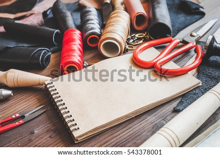 cobbler tools in workshop on wooden background mock up