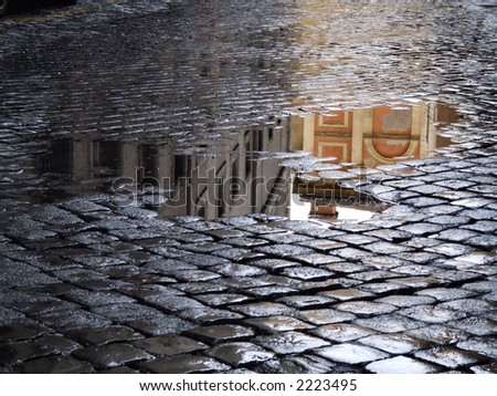 Cobblestone - old street in Rome (Italy). A view just after rain. - stock photo