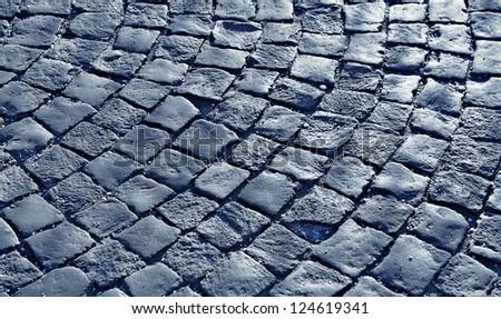 cobblestone pavement on a square. blue color tone - stock photo