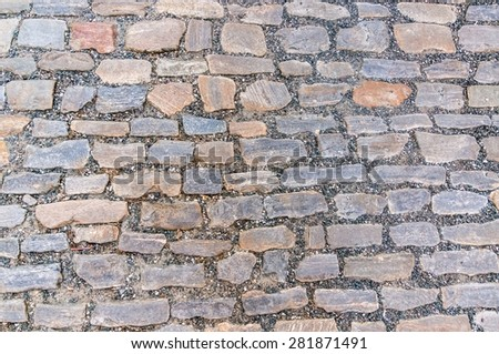 Cobblestone pavement on street in Prague, cobbled road background
