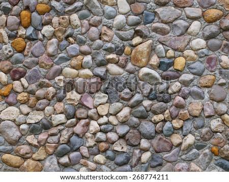 Cobblestone paving closeup, pebble way surface background - stock photo