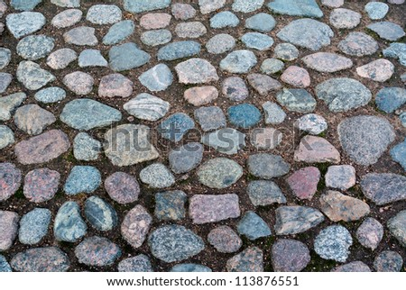 Cobblestone roadway - stock photo
