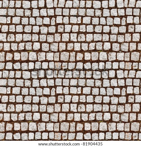 Cobblestone sidewalk made of cubic stones - tileable texture - stock photo