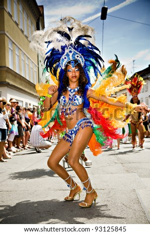 COBURG, GERMANY - JULY 11: An unidentified female samba dancer participates at the annual samba festival in Coburg, Germany on July 11, 2010. - stock photo