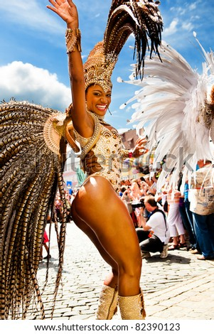 COBURG, GERMANY - JULY 10: An unidentified female samba dancer participates in the annual samba festival in Coburg, Germany on July 10, 2011. - stock photo