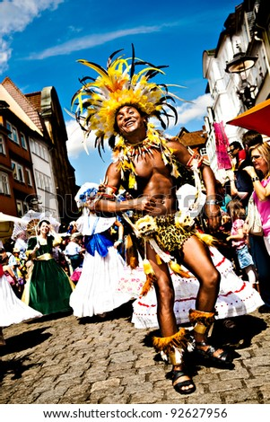 COBURG, GERMANY - JULY 10: An unidentified male samba dancer participates at the annual samba festival in Coburg, Germany on July 10, 2011. - stock photo