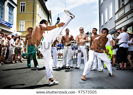 COBURG, GERMANY - JULY 11: The unidentified male capoeira dancers participate at the annual samba festival in Coburg, Germany on July 11, 2010. - stock photo