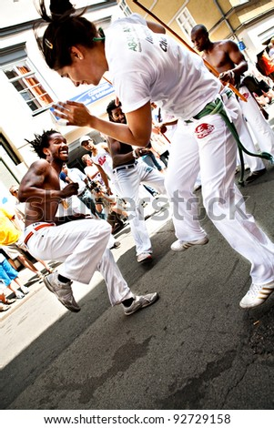 COBURG, GERMANY - JULY 11: Unidentified capoeira dancers participate at the annual samba festival in Coburg, Germany on July 11, 2010. - stock photo
