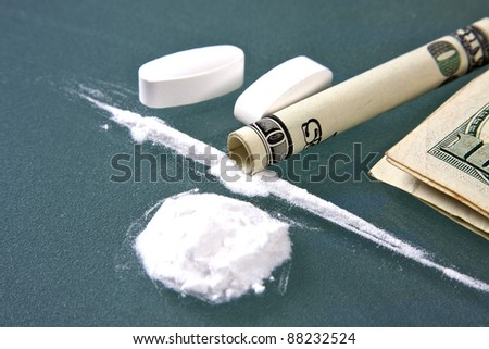Cocaine and drug money for snorting - stock photo