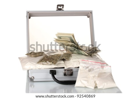 Cocaine and marijuana in a suitcase isolated on white - stock photo