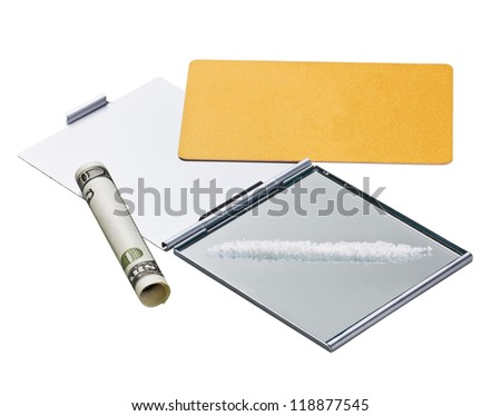 Cocaine (fake) lines on mirror with a credit card and rolled bill - stock photo