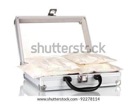 Cocaine in a suitcase isolated on white - stock photo