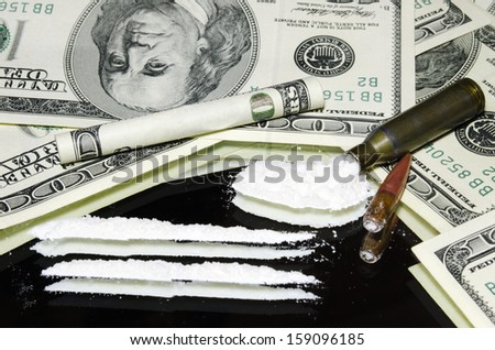 cocaine in the chuck and bills of 100 Dolar - stock photo
