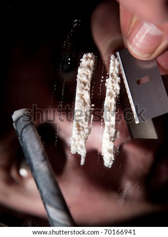 cocaine or other narcotic in line. addict with dollar bill for snorting illegal drugs - stock photo