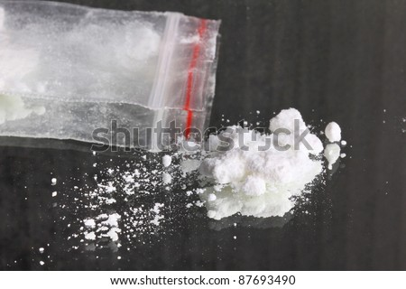 Cocaine pile and pocket with cocaine, closeup - stock photo