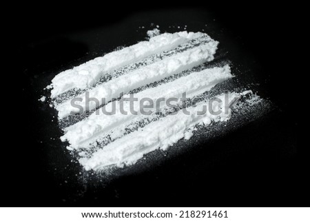 cocaine powder on black background