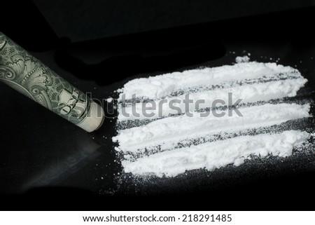 cocaine powder on black background - stock photo