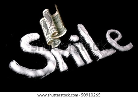 cocaine to the dollar on the mirror - stock photo