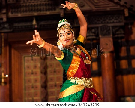 COCHIN, INDIA - JANUARY 21: Beautiful Indian girl dancing classical traditional Indian dance Bharat Natyam on January 21, 2016 in Kerala Kathakali Center in Fort Cochin, South India.