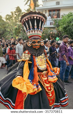 Cochin, India - January 1, 2016: Kathakali dancer performing on the streets of Fort Kochi during New Year carnival. Cochin Carnival held in the last week of December in Kerala since 1984.