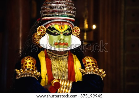 COCHIN, INDIA - NOVEMBER 23, 2015: Portrait of the unidentified kathakali performer during the traditional kathakali dance of Kerala's state in India. - stock photo