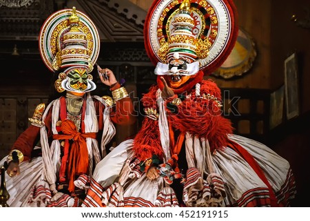 COCHIN, INDIA - NOVEMBER 23, 2015: Two unidentified kathakali performers during the traditional kathakali dance of Kerala's state in India. - stock photo