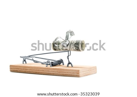 Cocked mousetrap with hundred dollars bill is isolated against a white background - stock photo