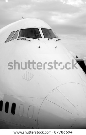 Cockpit closeup of a huge 747 airplane - stock photo