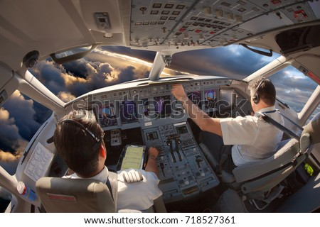Cockpit of a modern passenger aircraft. The pilots at work.