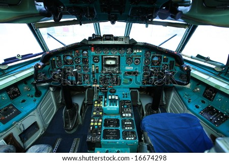 Cockpit of big old airplane - stock photo