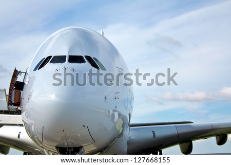 Cockpit of large passenger aircraft - stock photo