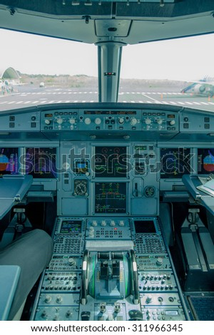 cockpit view of airplane interior ready for departure - stock photo