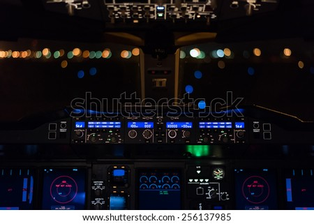Cockpit view of commercial aircraft. - stock photo