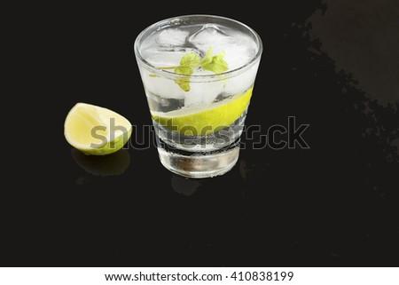 cocktail, alcohol, tequila, gin, vodka, ice, lemon, lime. closeup - stock photo