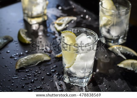 cocktail, alcohol, tequila, gin, vodka, ice, lemon, lime. closeup