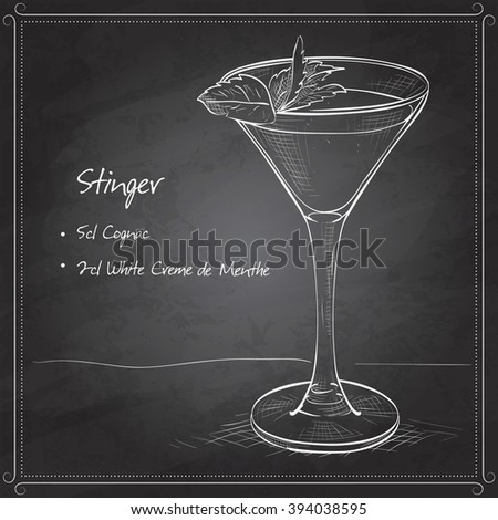 Cocktail alcoholic Stinger on black board. It consists of Cognac, Liqueur Peppermint, Ice cubes
