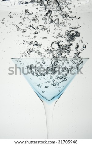 Cocktail and creative splashing.Isolated on white