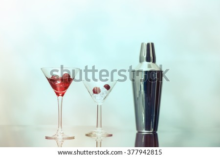 Cocktail bar with Art Deco glasses and cocktail shaker - stock photo