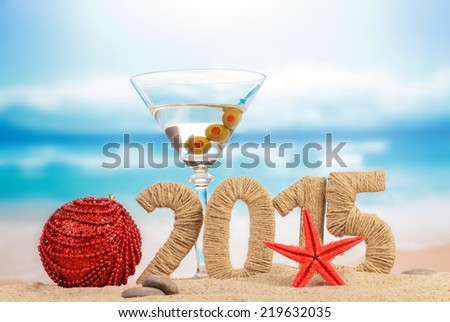 Cocktail, Christmas ball and New year sign - stock photo