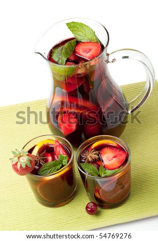 Cocktail collection - Refreshing fruit sangria in jug and two glasses. Above view, isolated on white - stock photo