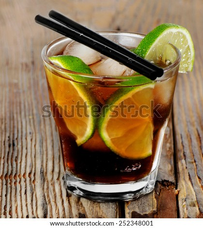 Cocktail Cuba Libre on  wooden board - stock photo