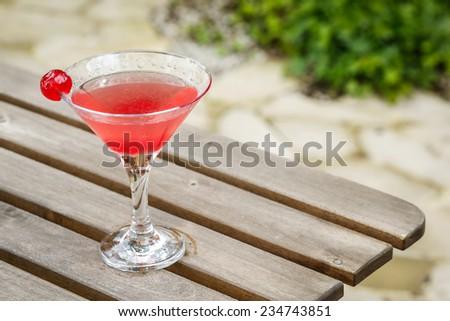 cocktail drink margarita in a garden on a garden table - stock photo