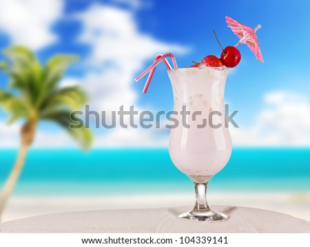 Cocktail drink on beach - stock photo